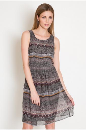 Sukienka we wzory z marszczeniem w talii