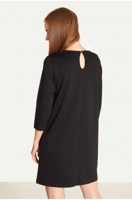 Prosta sukienka z zameczkami