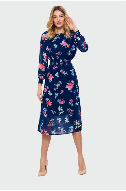 Sukienka z ozdobną falbanką przy dekolcie